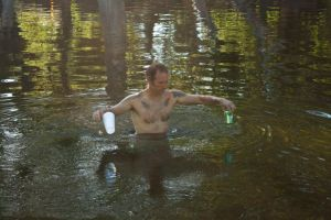 Unidentified swimmer retrieving trash from Sycamore Pool.   :)