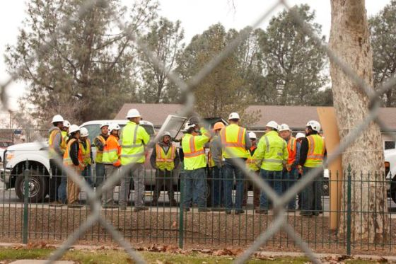 PG&E workers huddle.