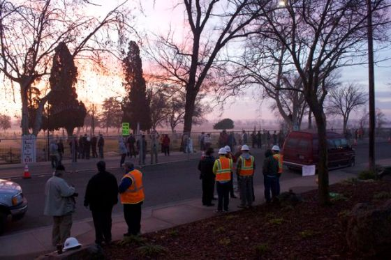 PG&E employees on the outside of the fence.